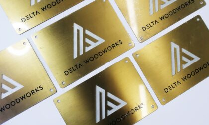 Laser Cut Brass Plaque with Brushed Surface and Countersinks for a Wood Workshop
